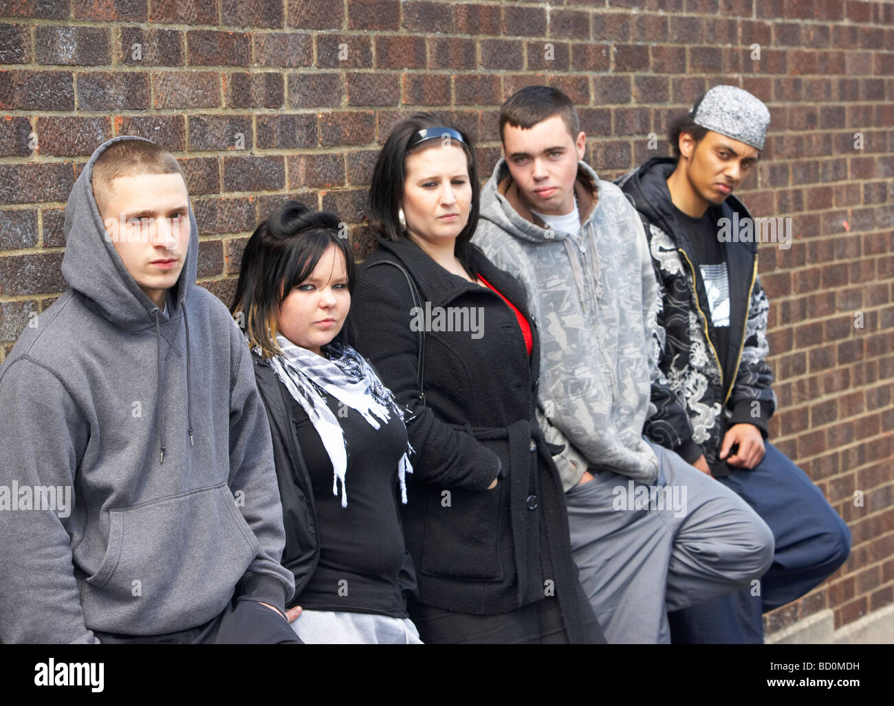 Gang Of Youths Leaning On Wall - Stock Image