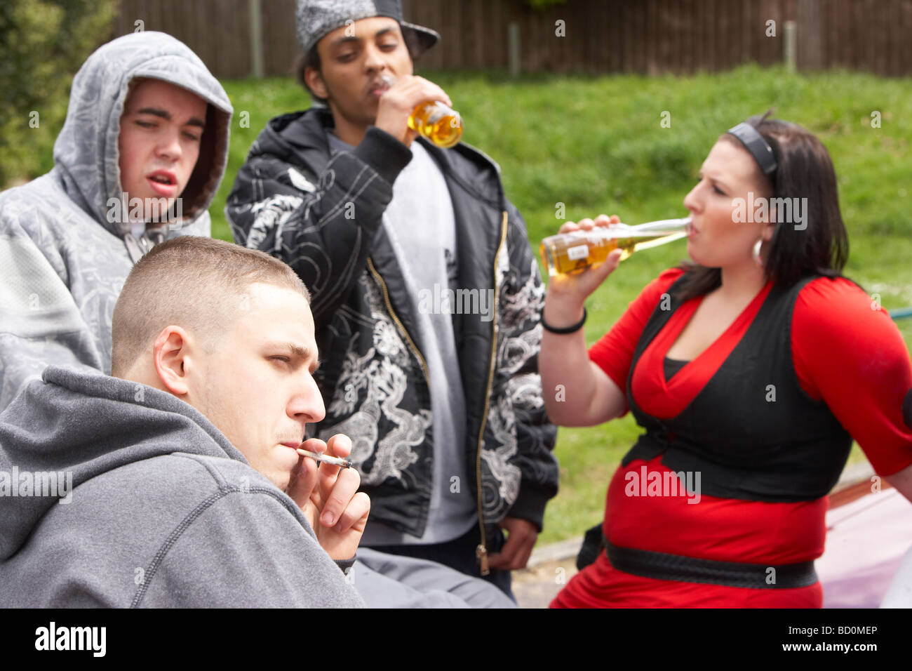Gang Of Youths Sitting On Cars - Stock Image