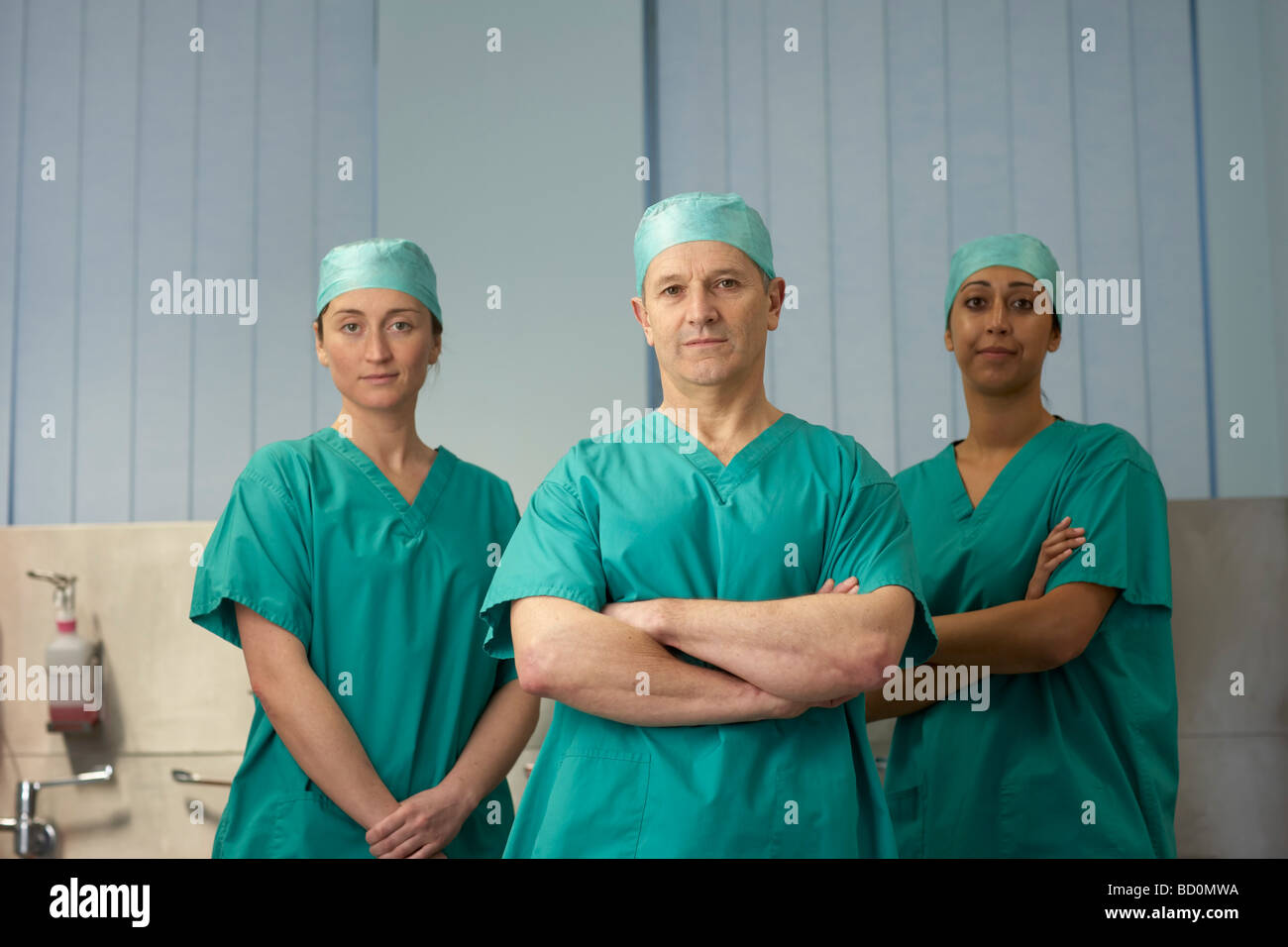 Three medical staff in scrubs - Stock Image