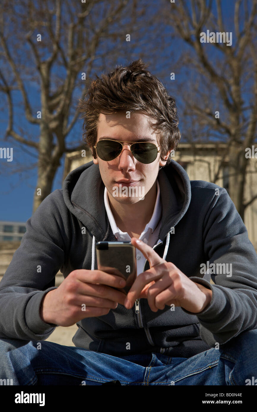 Man looking on pda - Stock Image