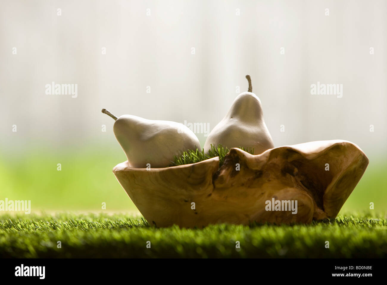 Silver pears in wooden bowl. Stock Photo