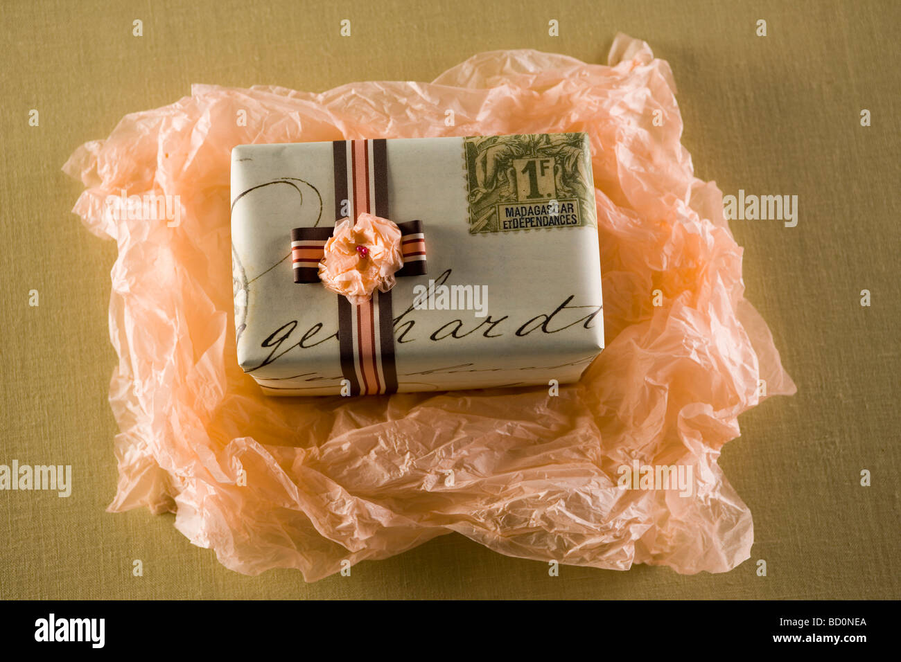 Gift being unwrapped - Stock Image