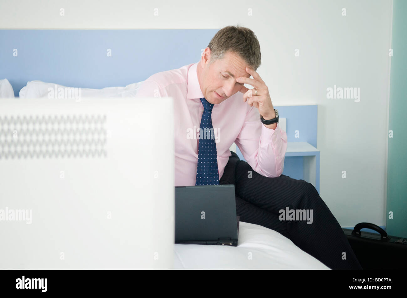 A portrait of a stressed businessman - Stock Image