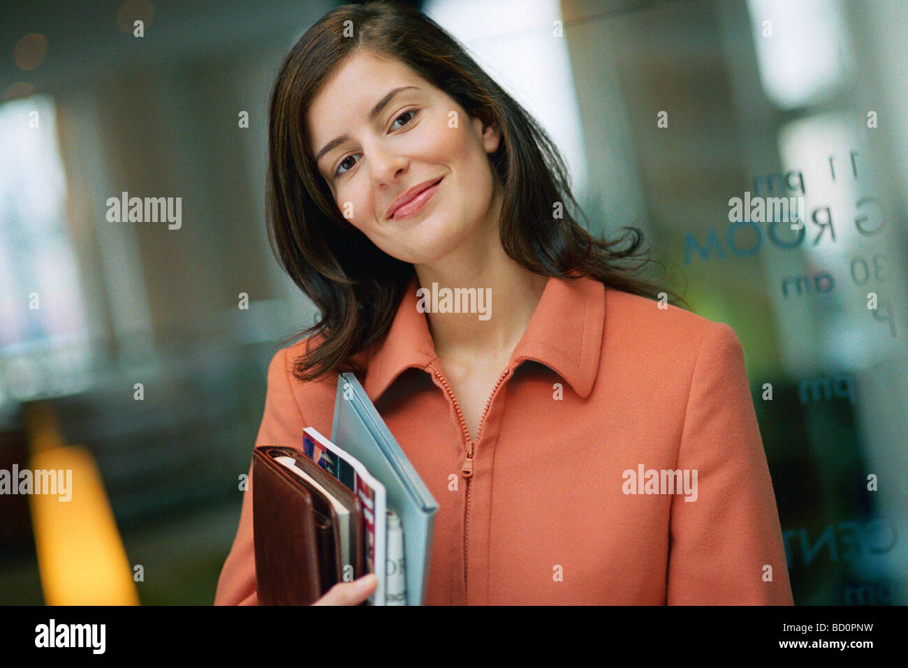 Businesswoman smiling at camera, portrait - Stock Image
