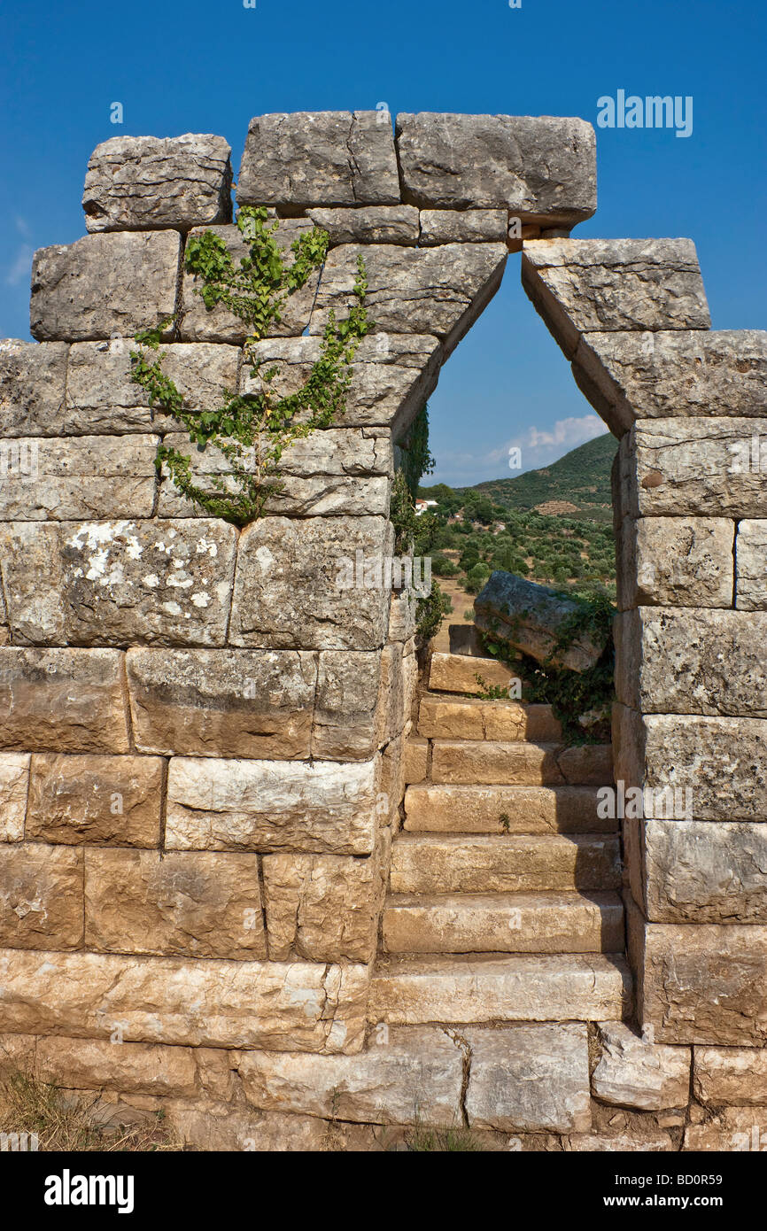A corbelled portal in the Hellenistic fortifications at Messene, Greece. - Stock Image