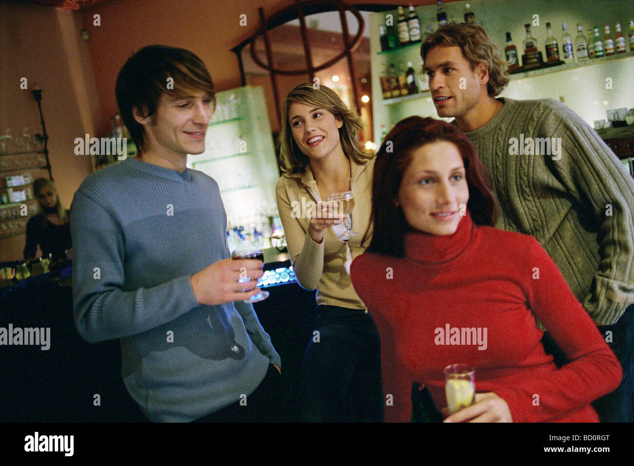 Friends talking, having drinks together at wine bar - Stock Image