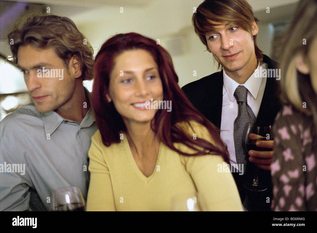 Young man watching woman at bar Stock Photo