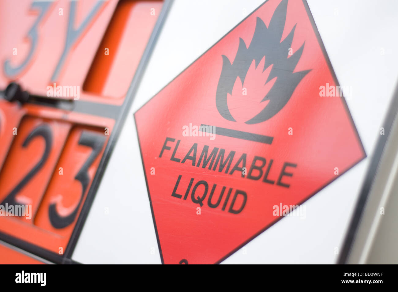Close up of a flammable liquid sign on the back of a tanker carrying dangerous liquid on the road - Stock Image