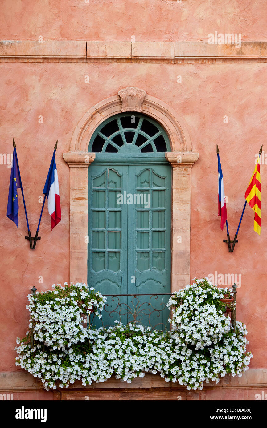 Door balcony on building in Roussillon, Provence France - Stock Image