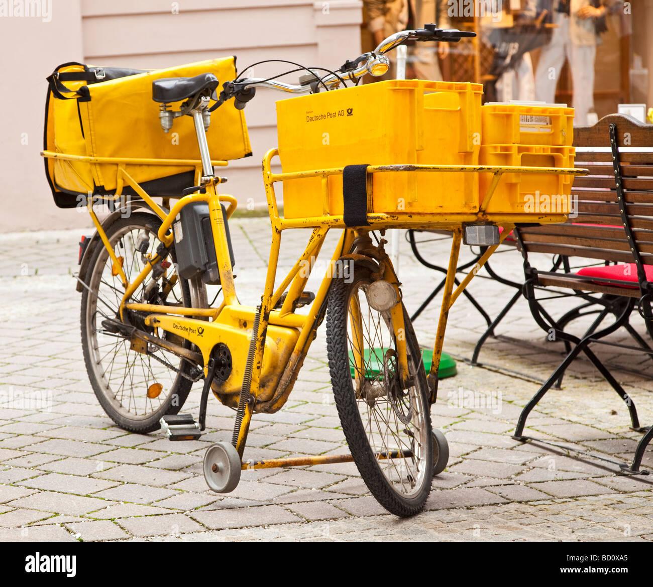 Postmans bicycle Deutsche Post, Germany, Europe - Stock Image