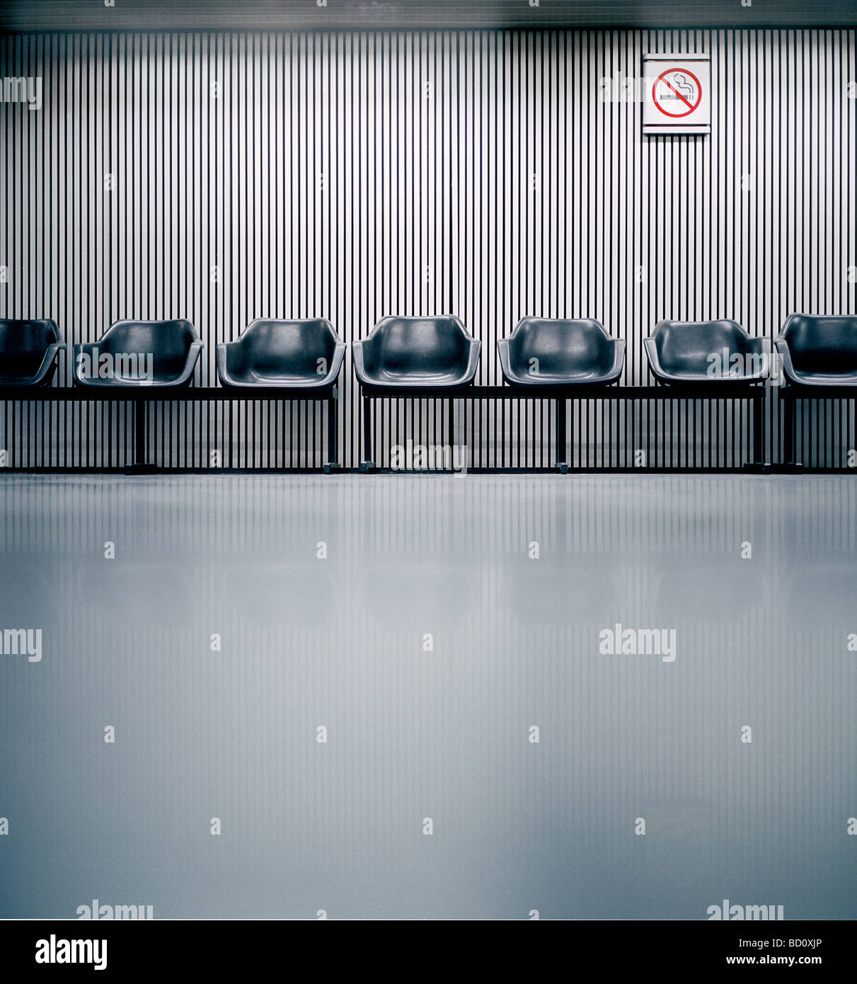 airport seats in waiting area - Stock Image