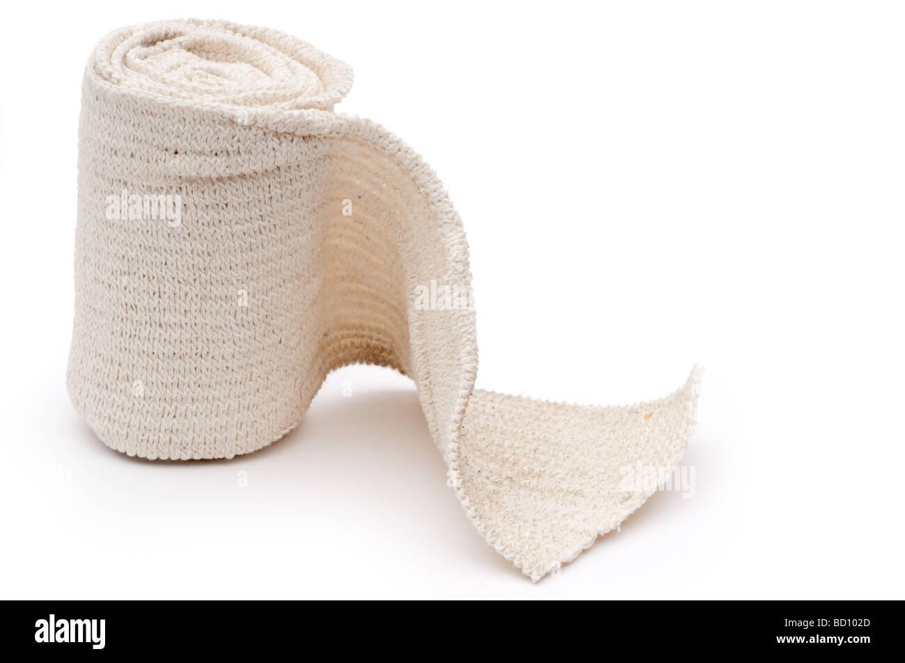 Horizontal image of a roll of medical bandage - Stock Image