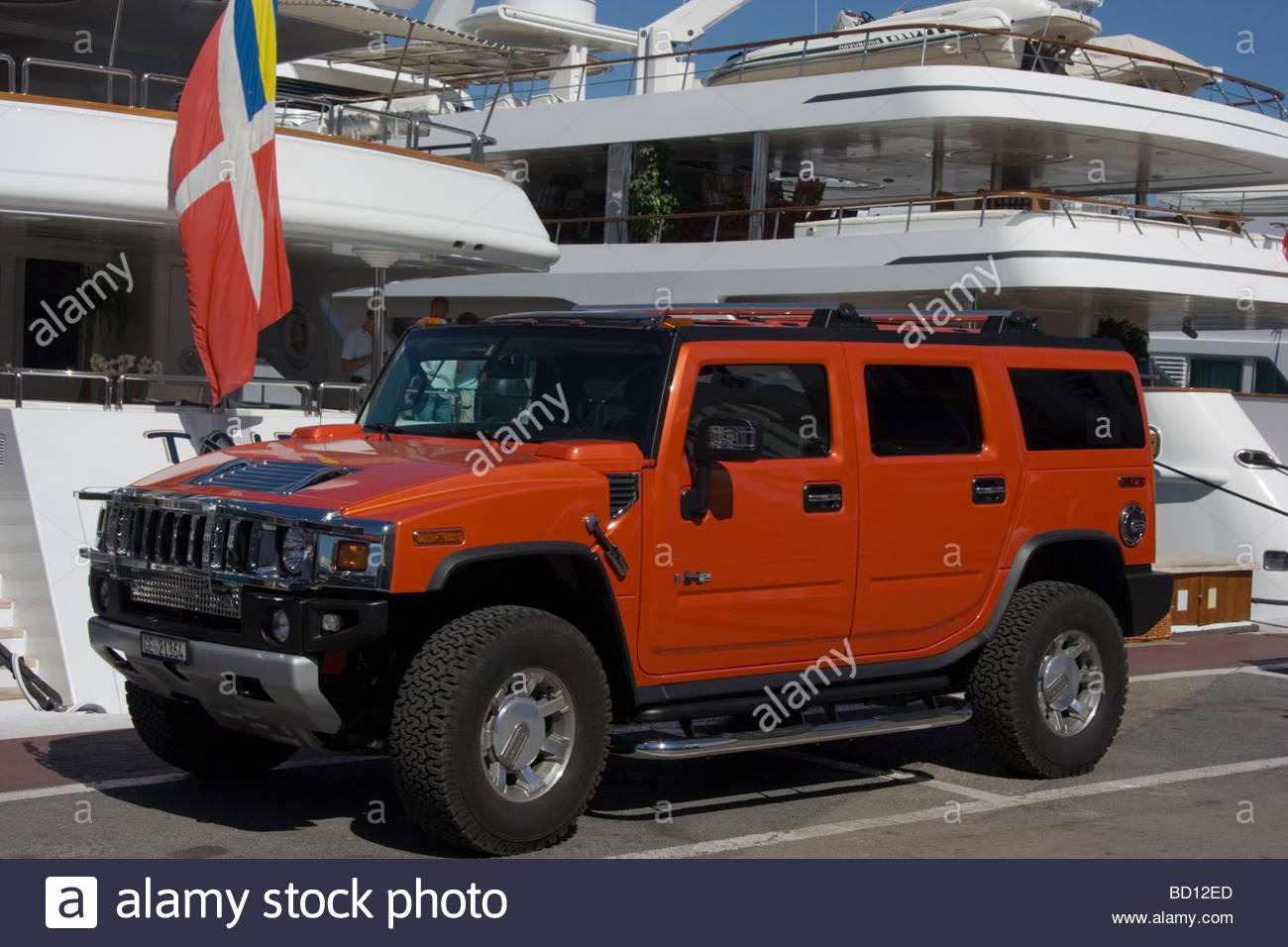 Spain Puerto Banus Hummer and Luxury yachts - Stock Image