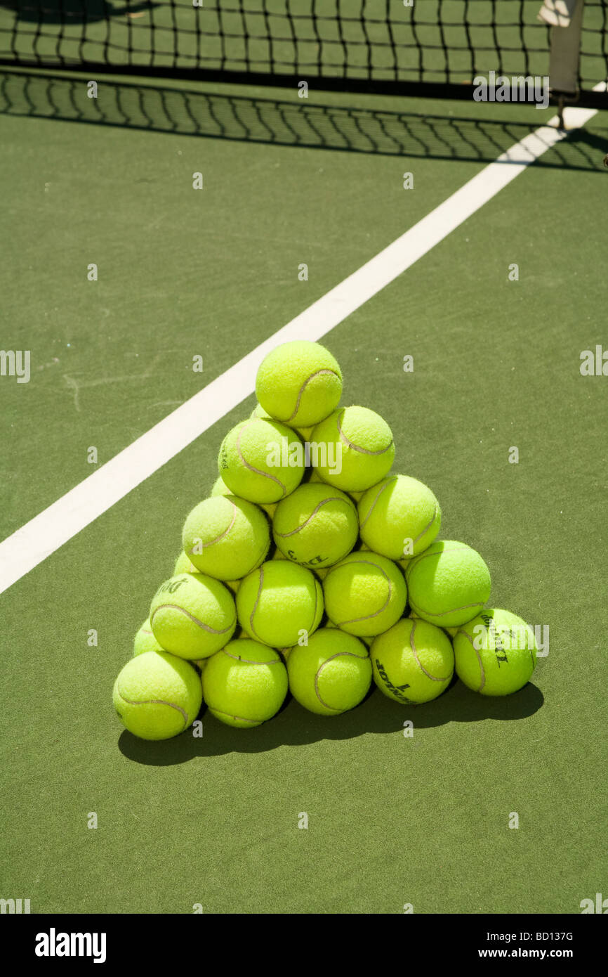 Tennis Balls stacked to form a regular tetrahedron. - Stock Image