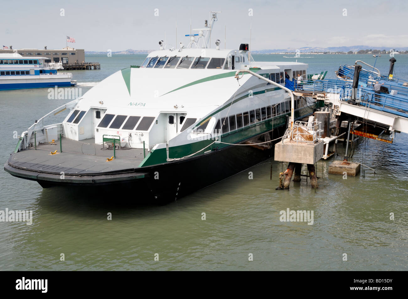 Modern catamaran ferry boat prepares for passengers to embark - Stock Image