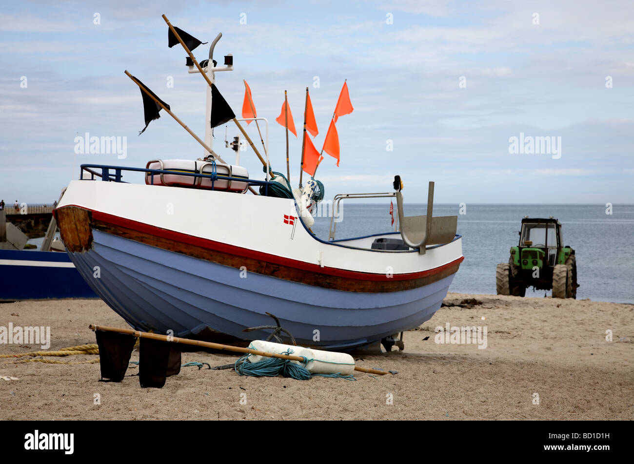 Fishing boats pulled up on the beach at Vorupør on the west coast of Jutland, Denmark. - Stock Image
