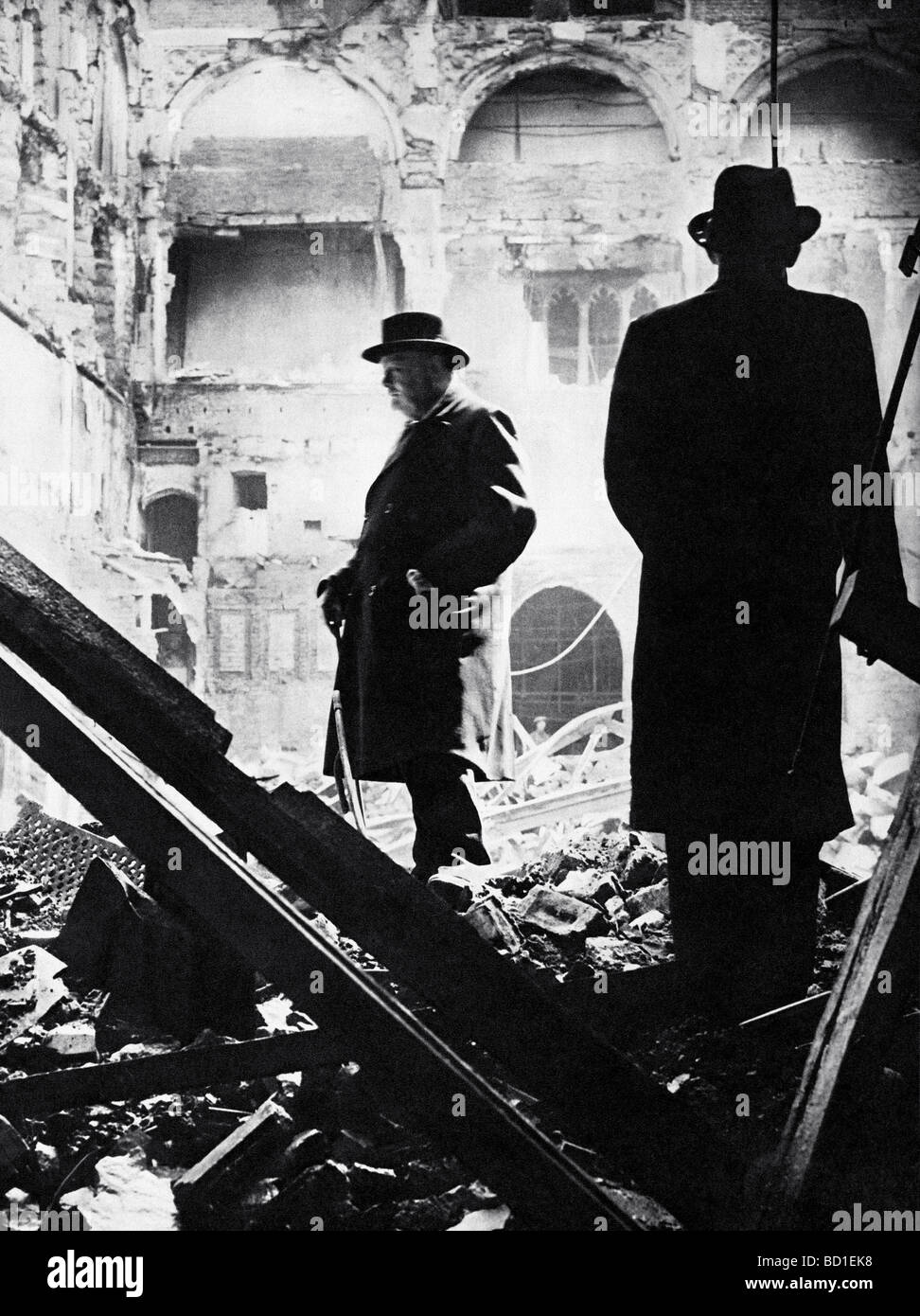 WINSTON CHURCHILL  inspects the ruins of the House of Commons after a night raid on 10/11 May 1941 - Stock Image