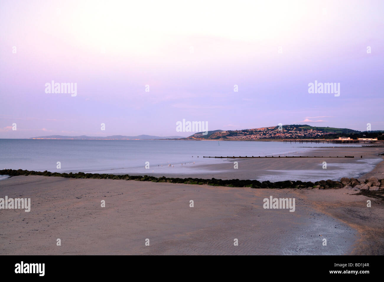 Colwyn Bay a view of Colwyn pier at dusk. - Stock Image