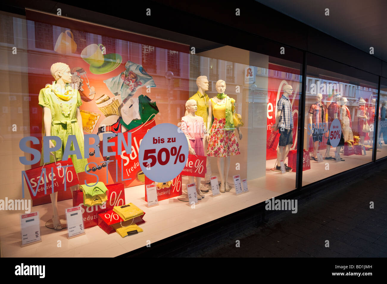 Department store window display with sale items in Germany, Europe - Stock Image