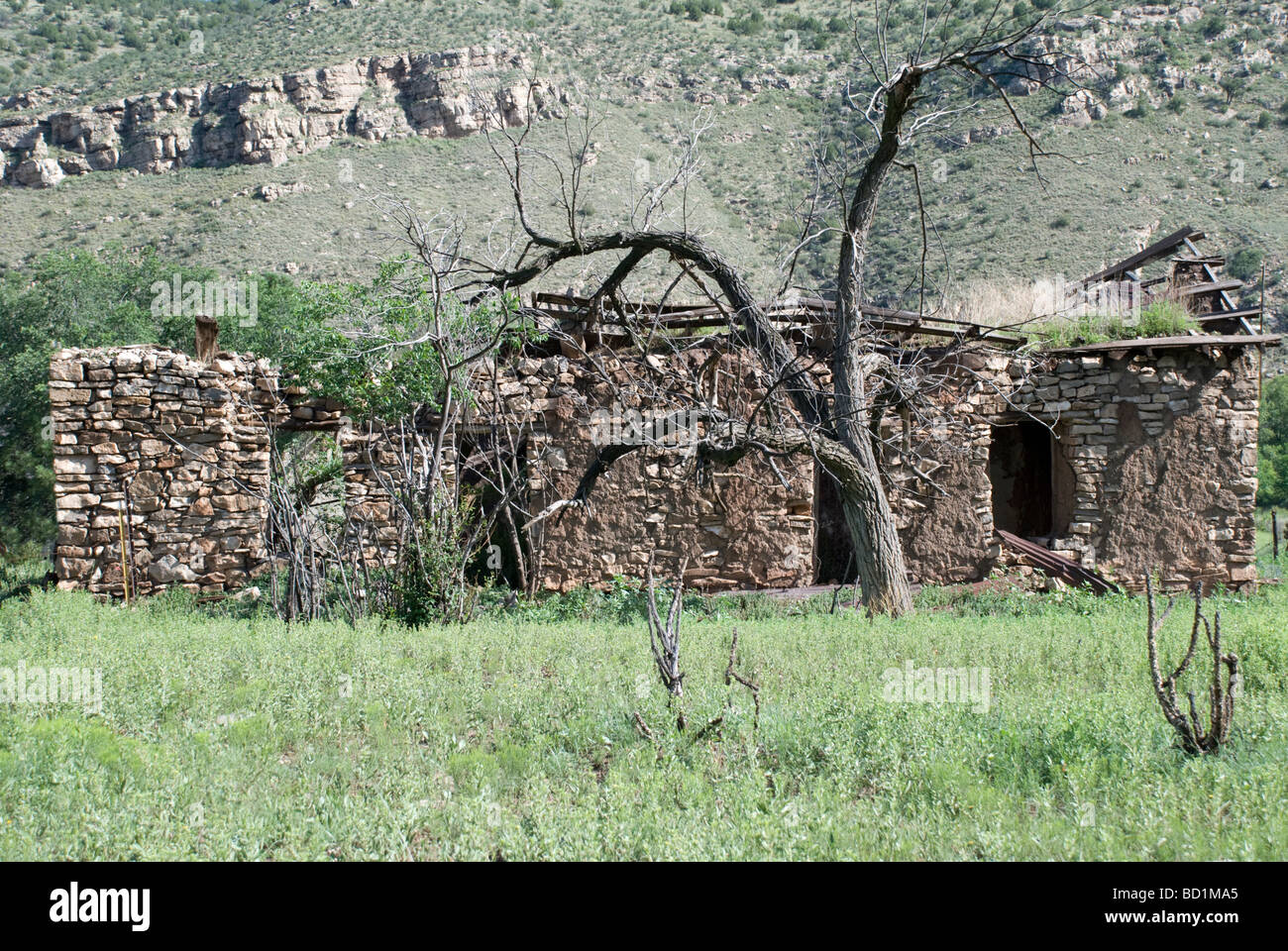 This old abandoned stone and adobe house nestled in the Bonito River Valley is near historic Lincoln, New Mexico. - Stock Image