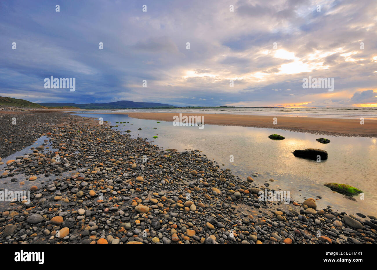 evening light illuminates beach and shoreline at Strandhill Co Sligo Ireland - Stock Image