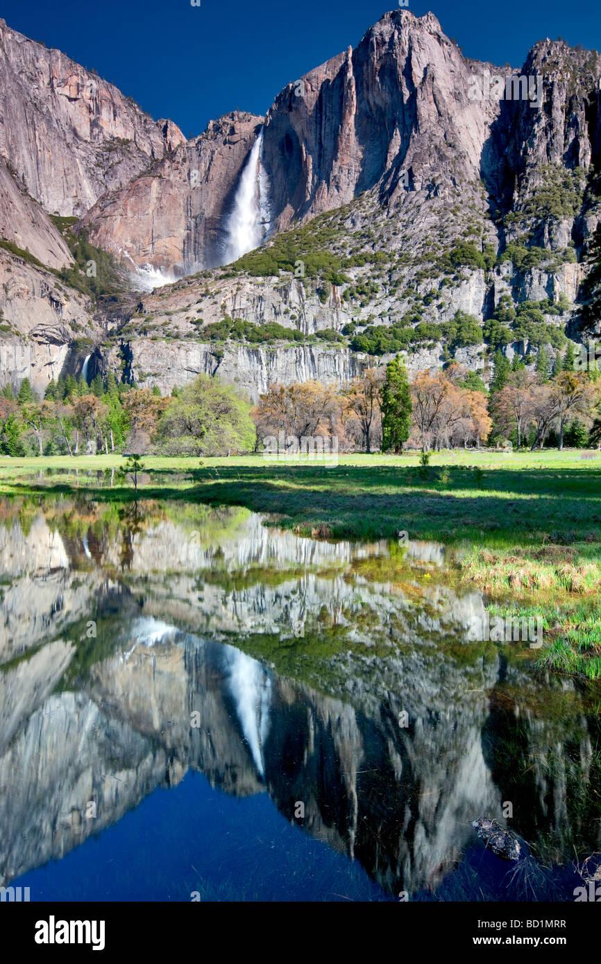 Yosemite Falls reflected in pool of water Yosemite National Park California Stock Photo
