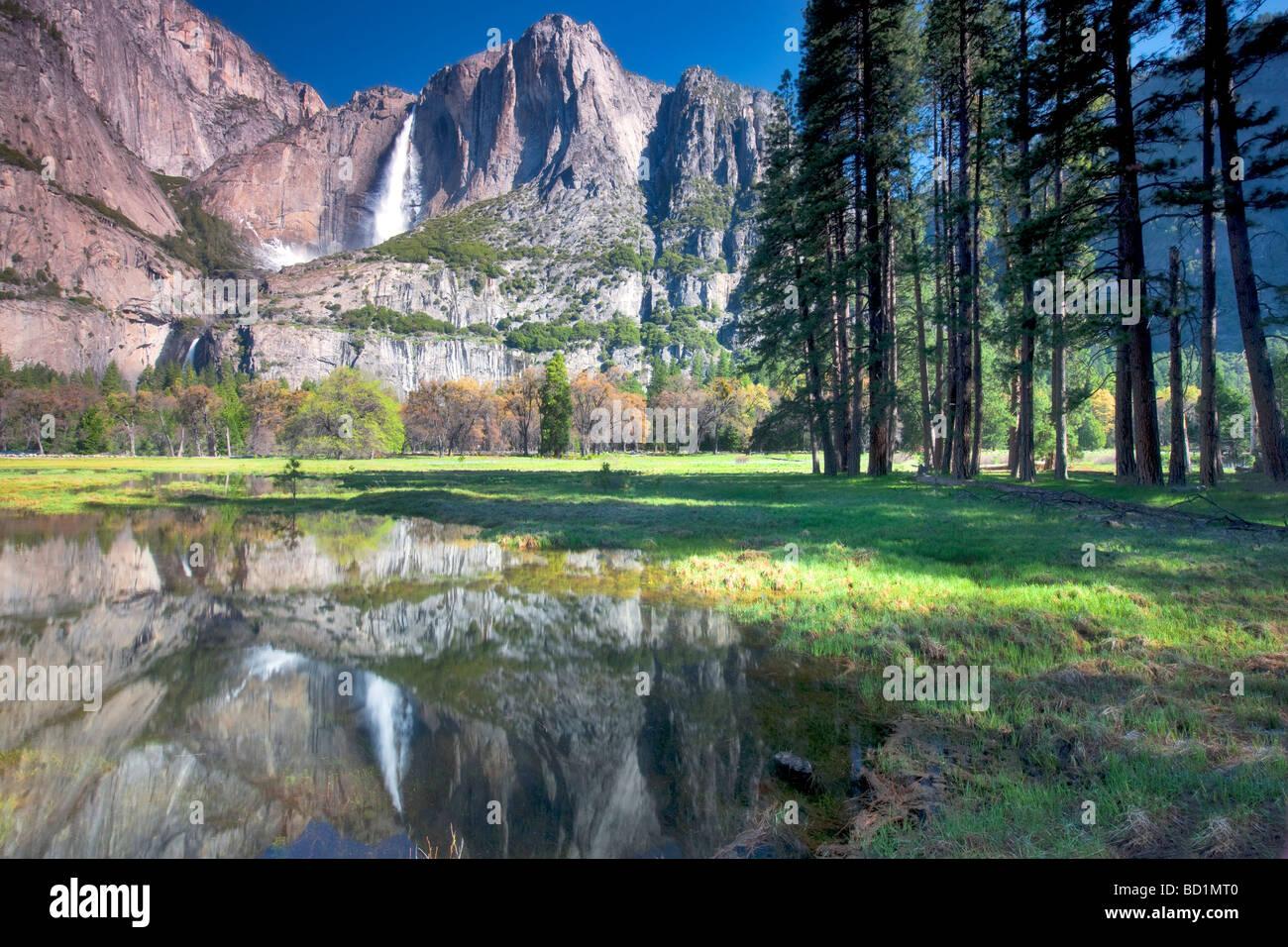 Yosemite Falls reflected in pool of water Yosemite National Park California - Stock Image