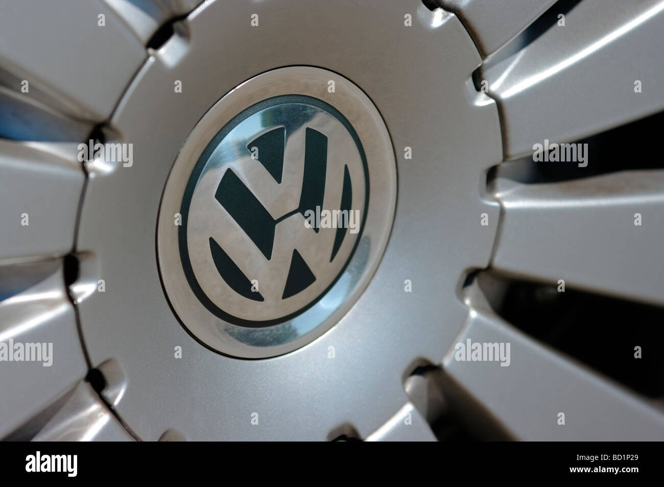 VW badge on alloy wheel - Stock Image