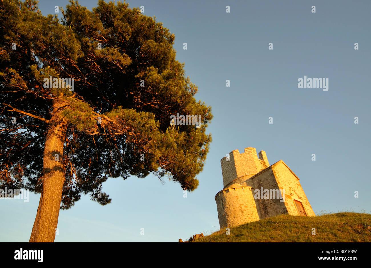 Tree and Romanesque St Nicolas Nicola Church Located on Earthen Hill in Fields of Prahulje near Nin in Dalmatia Stock Photo
