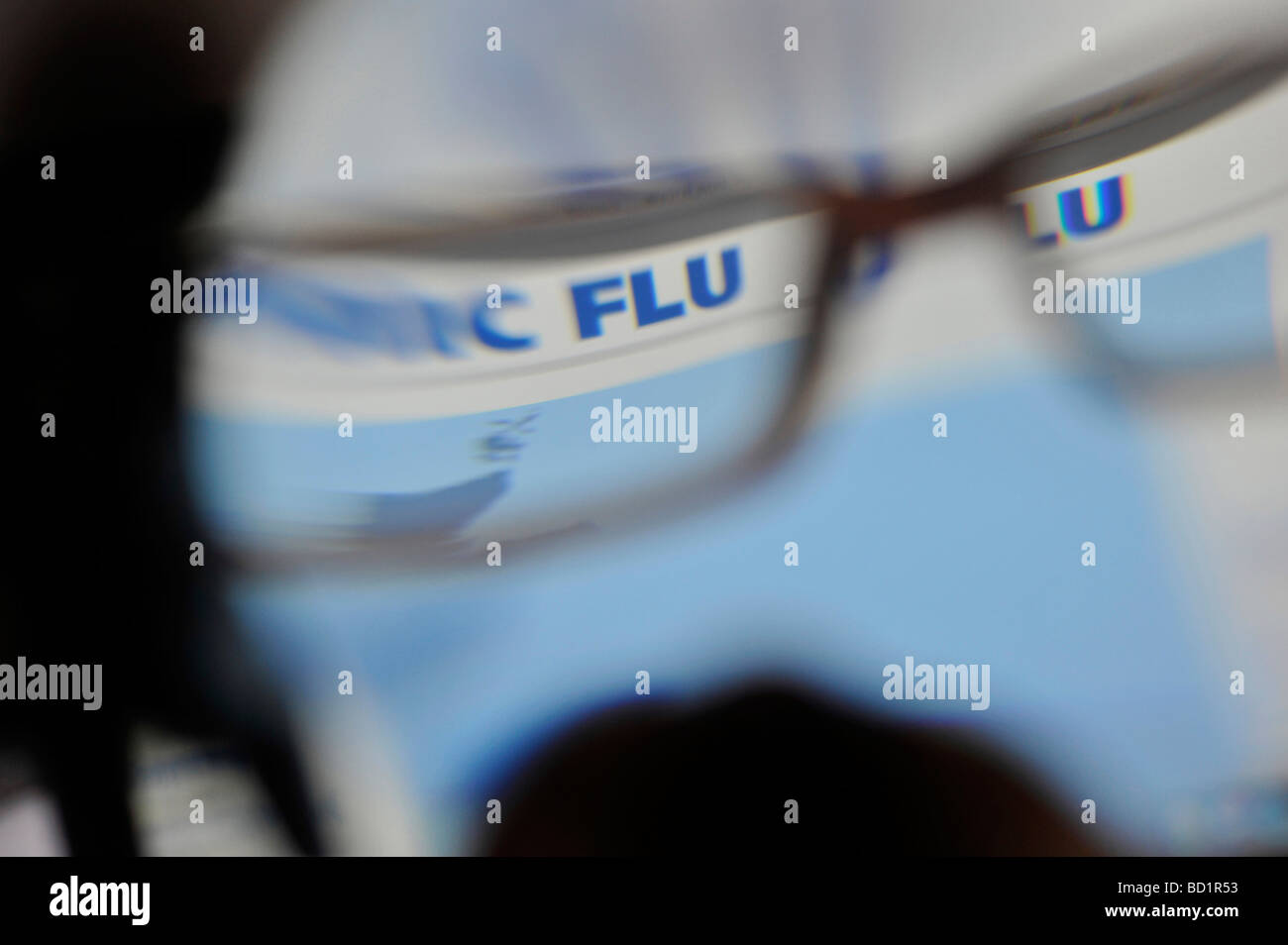 Pandemic flu hotline website on the internet for UK through blurry glasses Stock Photo