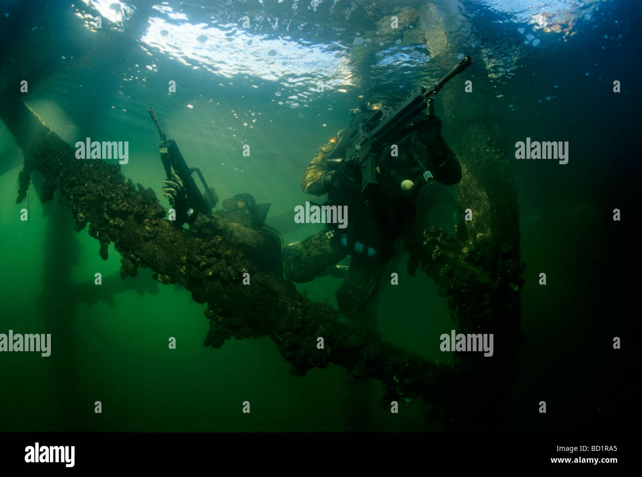 Two soldiers of the German special forces Kampfschwimmer unit in training for undercover attack with oxygen rebreathers, - Stock Image