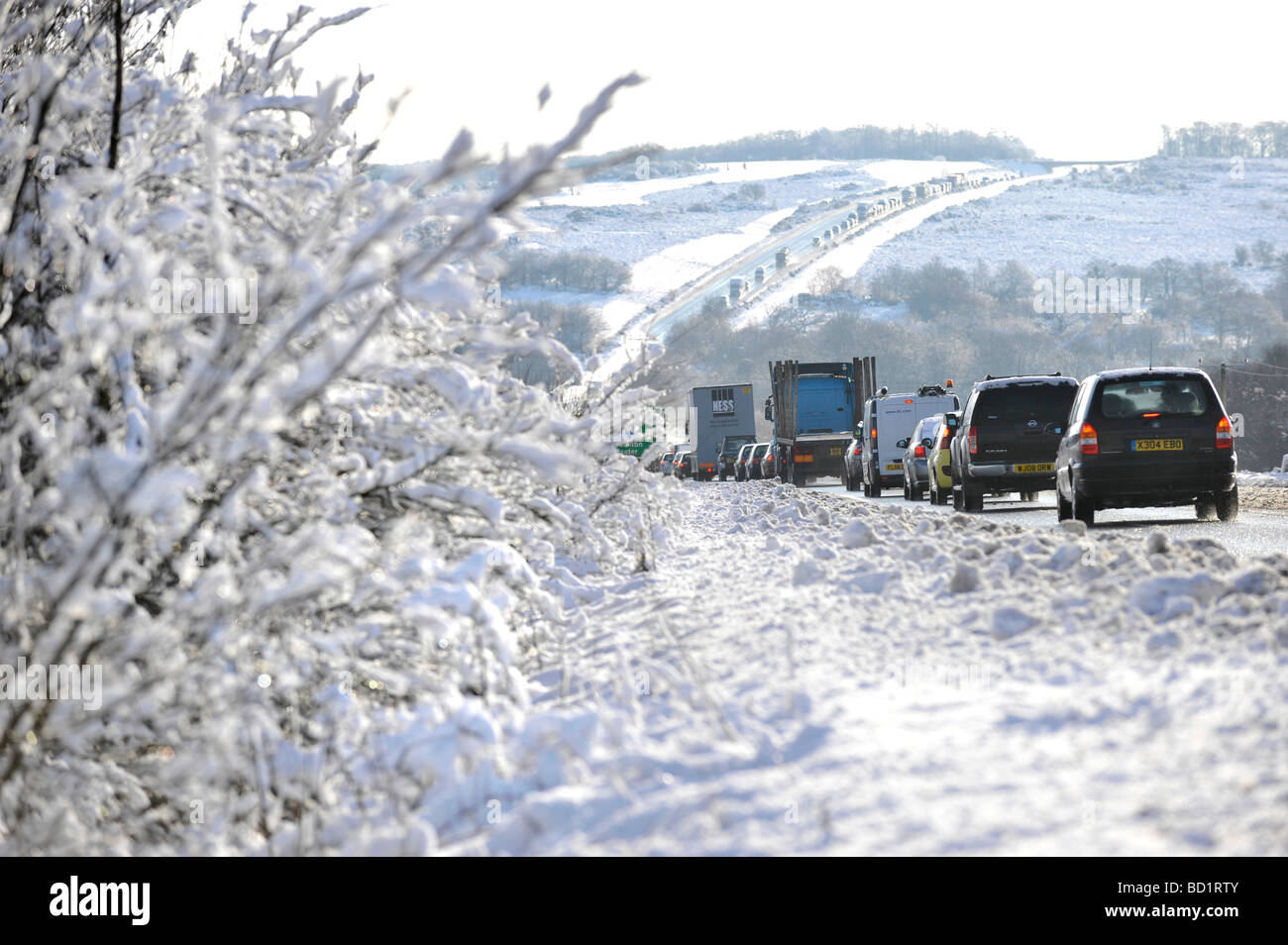 winter snow and bad weather causes traffic chaos on the A361 between Tiverton and Barnstaple, Devon, uk - Stock Image