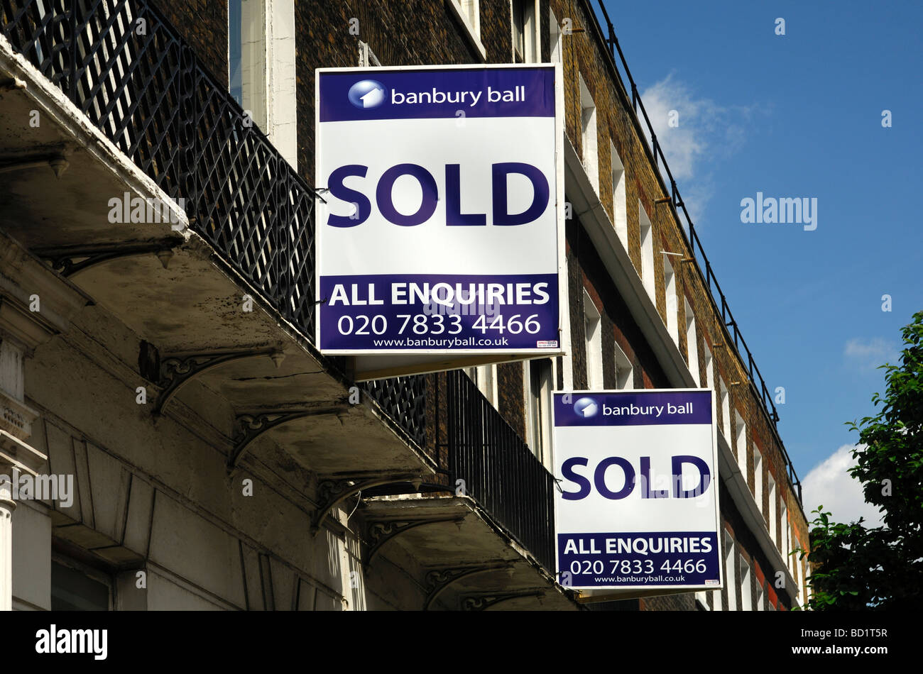 Sold signs of the Banbury Ball estate agents at a building London United Kingdom - Stock Image