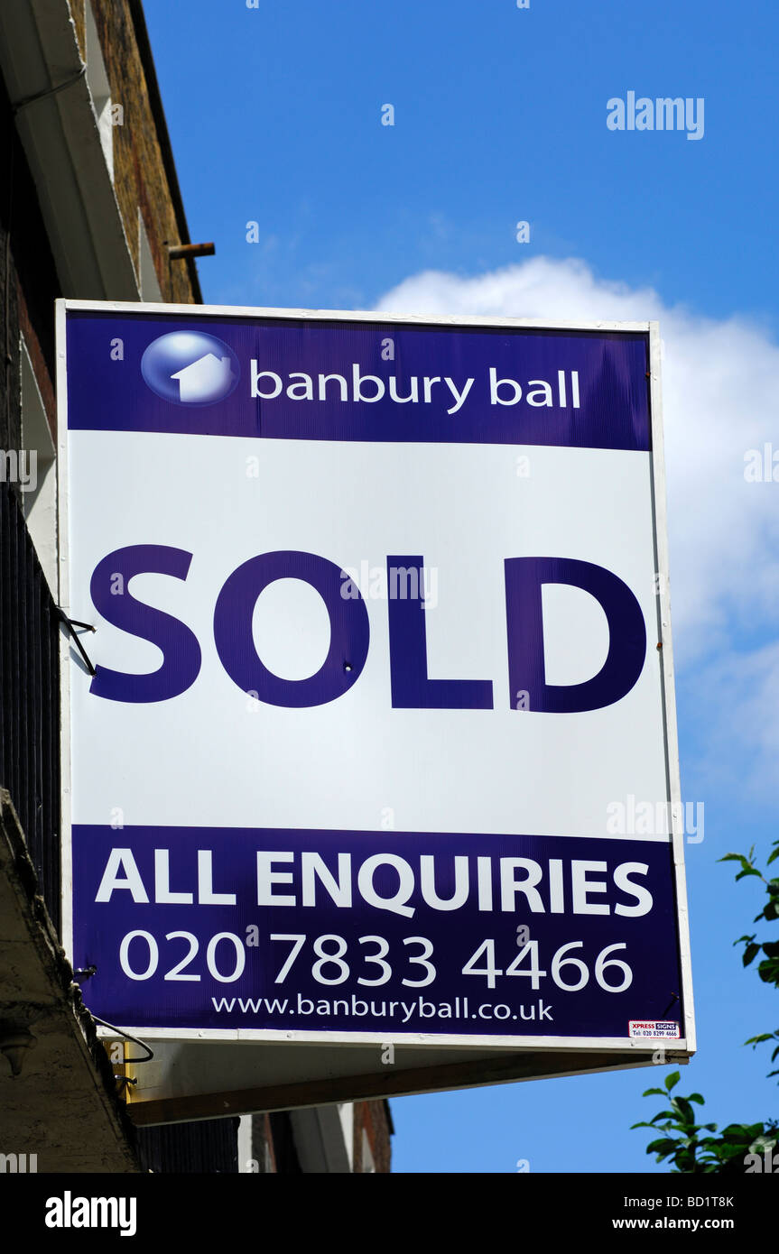 Sold signs of the Banbury Ball estate agents at a building, London, United Kingdom - Stock Image