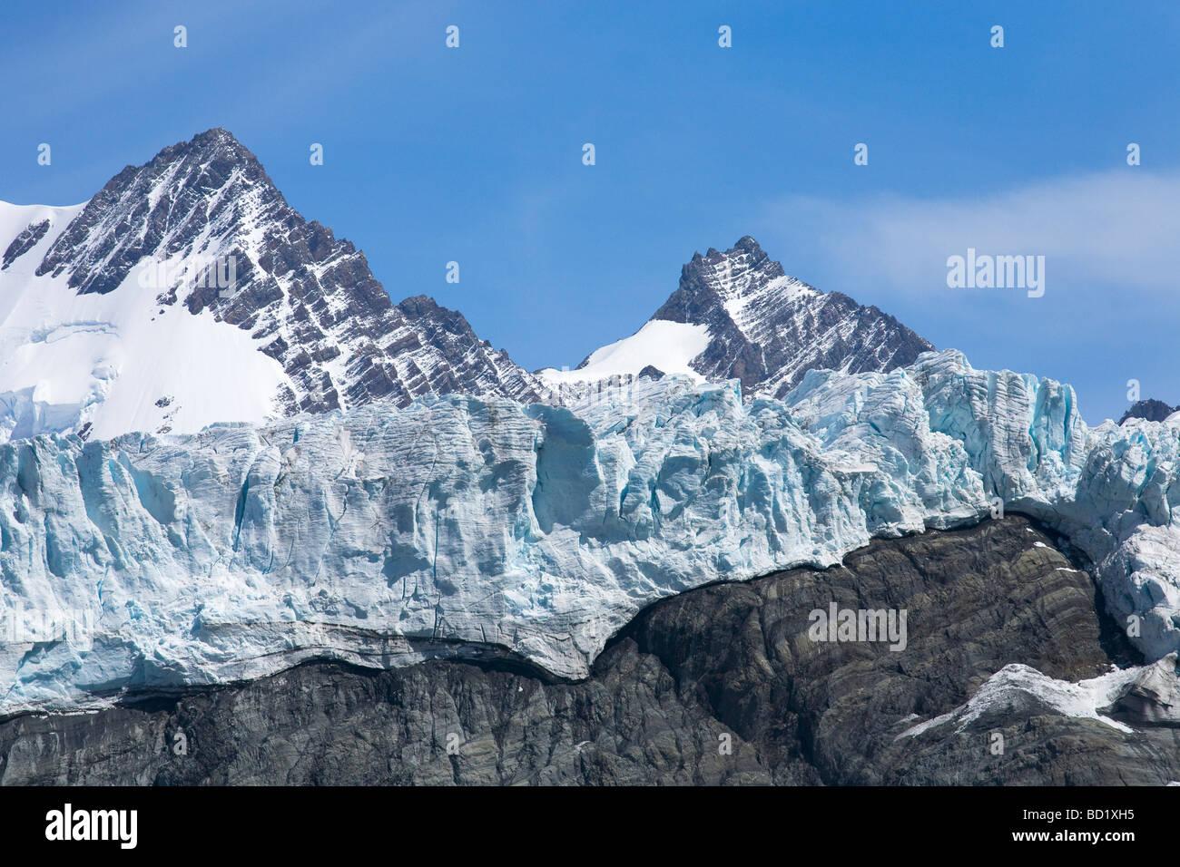 Bertrab hanging glacier clings to rockface at Gold Harbour South Georgia Antarctica Stock Photo