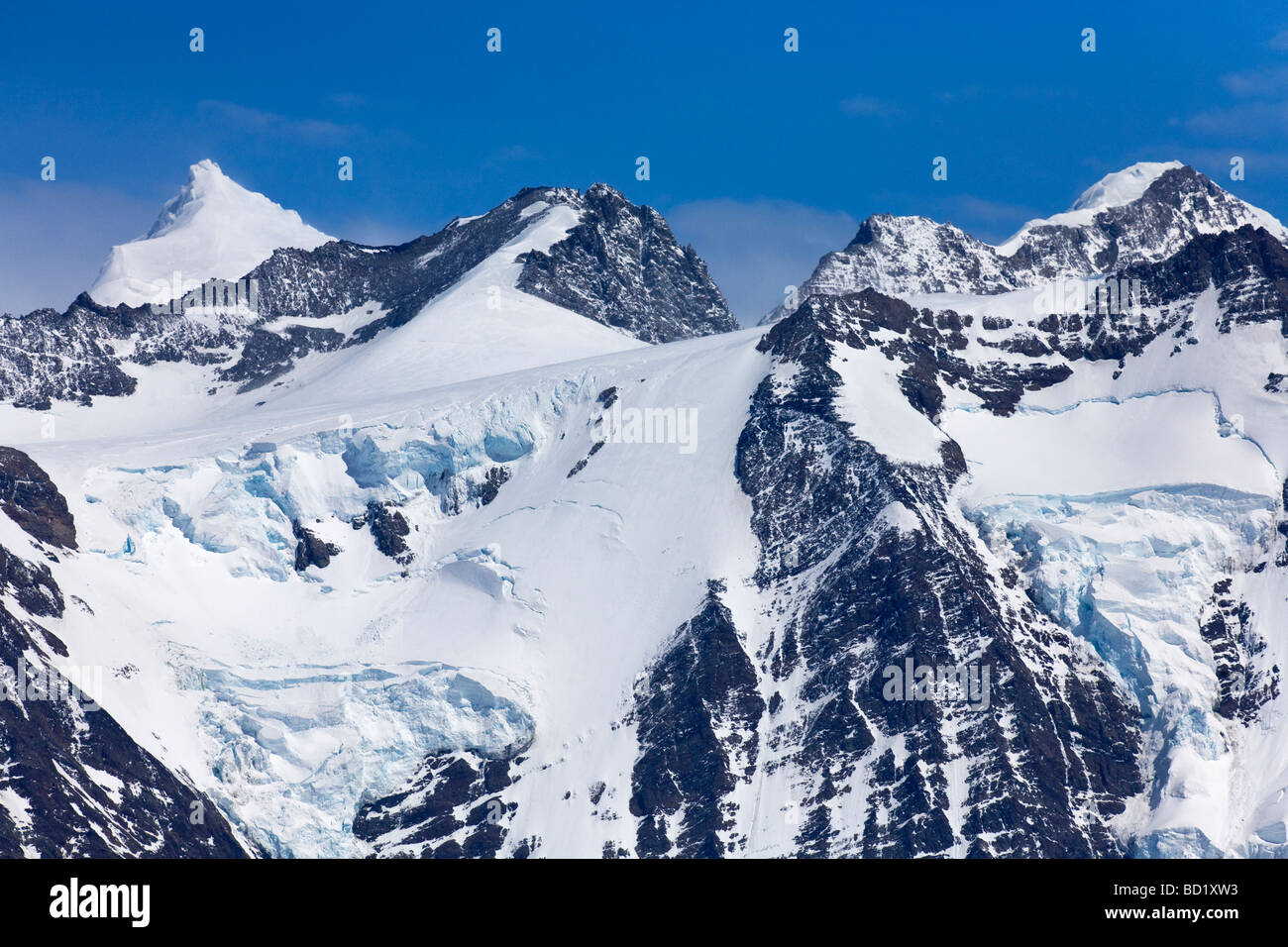 Mountain peaks and glaciers behind Gold Harbour South Georgia Antarctica Stock Photo
