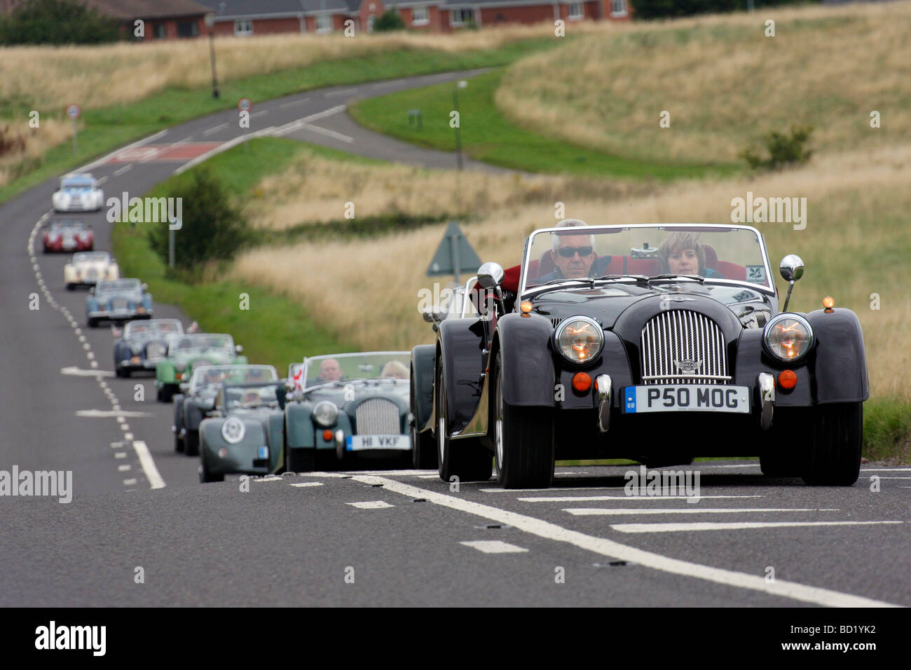 Cavalcade of Morgan sports cars passing by Peachfield Common in Malvern Worcs on the 100 year anniversary of Morgan - Stock Image