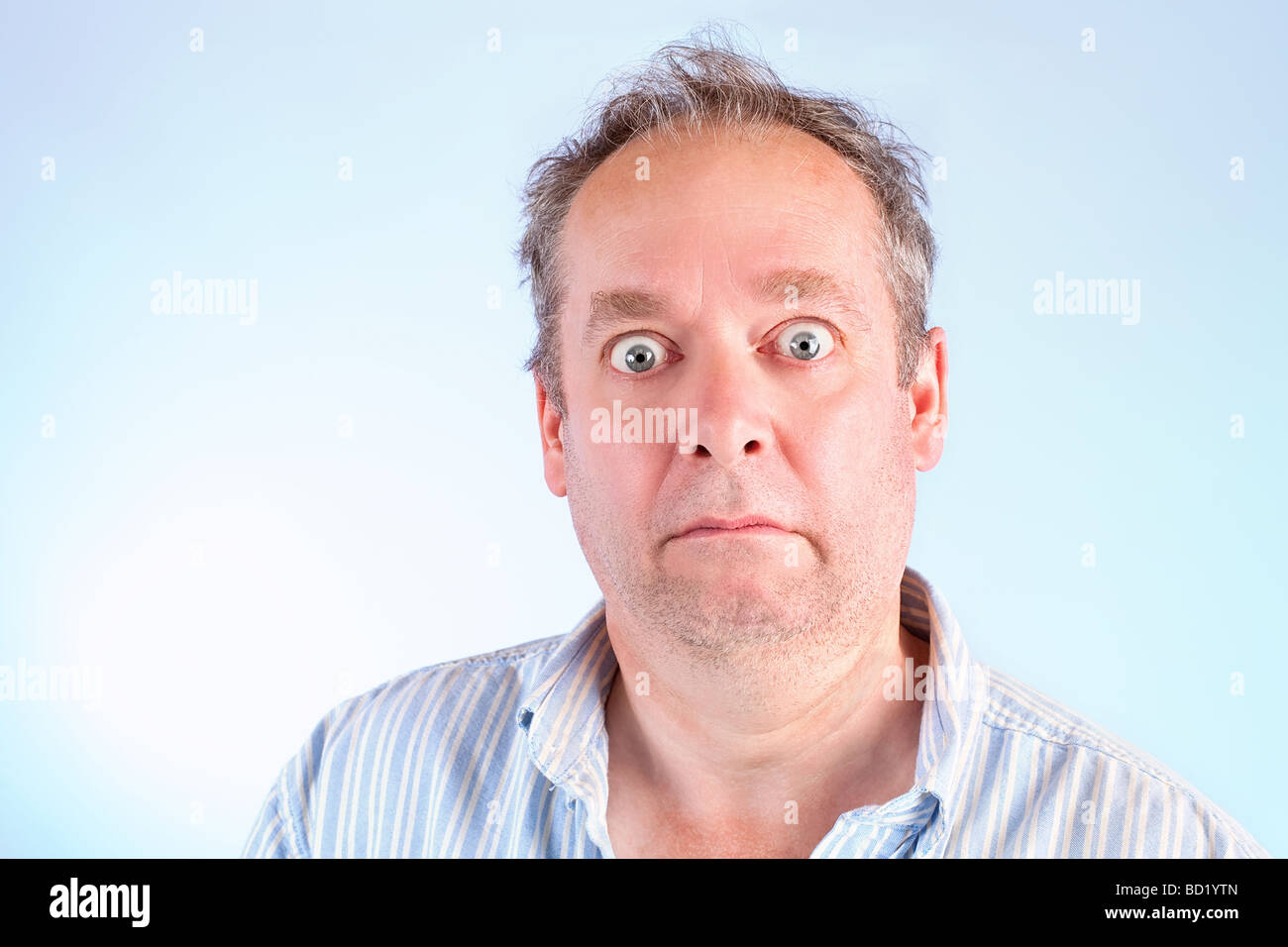 A man appear to be stunned about something - Stock Image