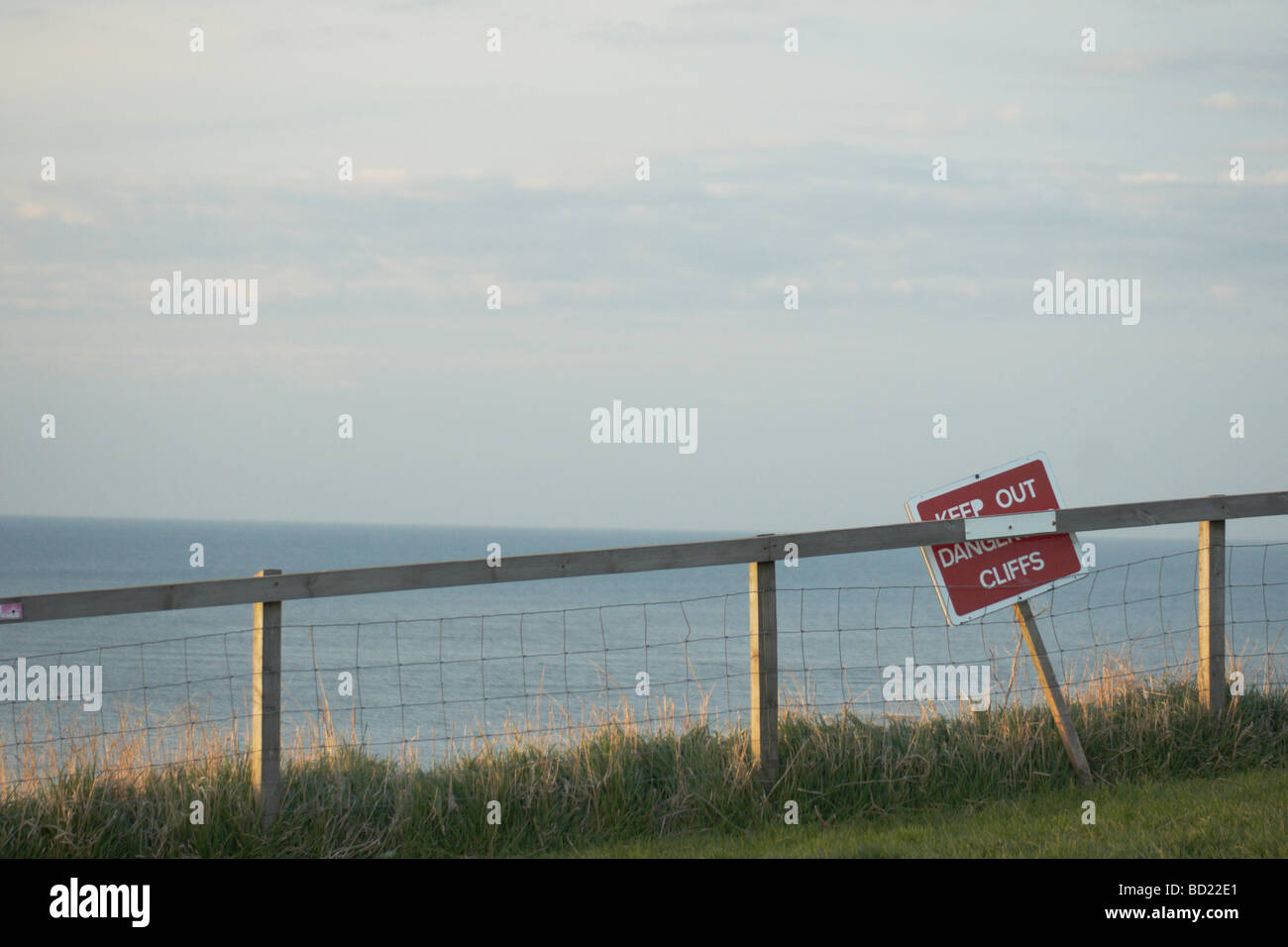 Danger sign at the cliff above Whitby harbour - Stock Image
