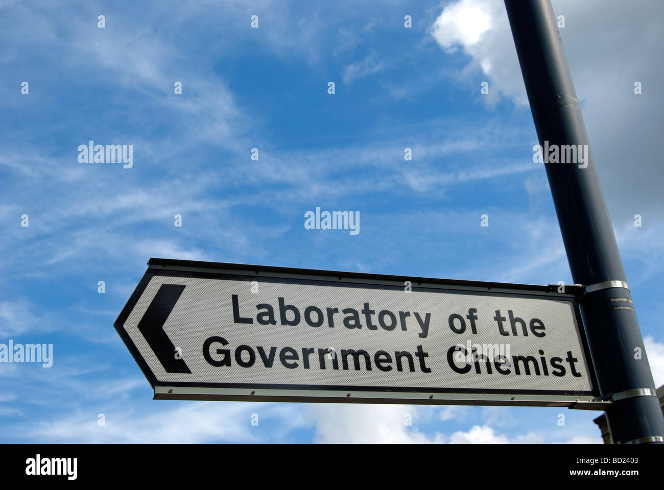 left pointing street sign for the laboratory of the government chemist, in teddington, middlesex, england - Stock Image