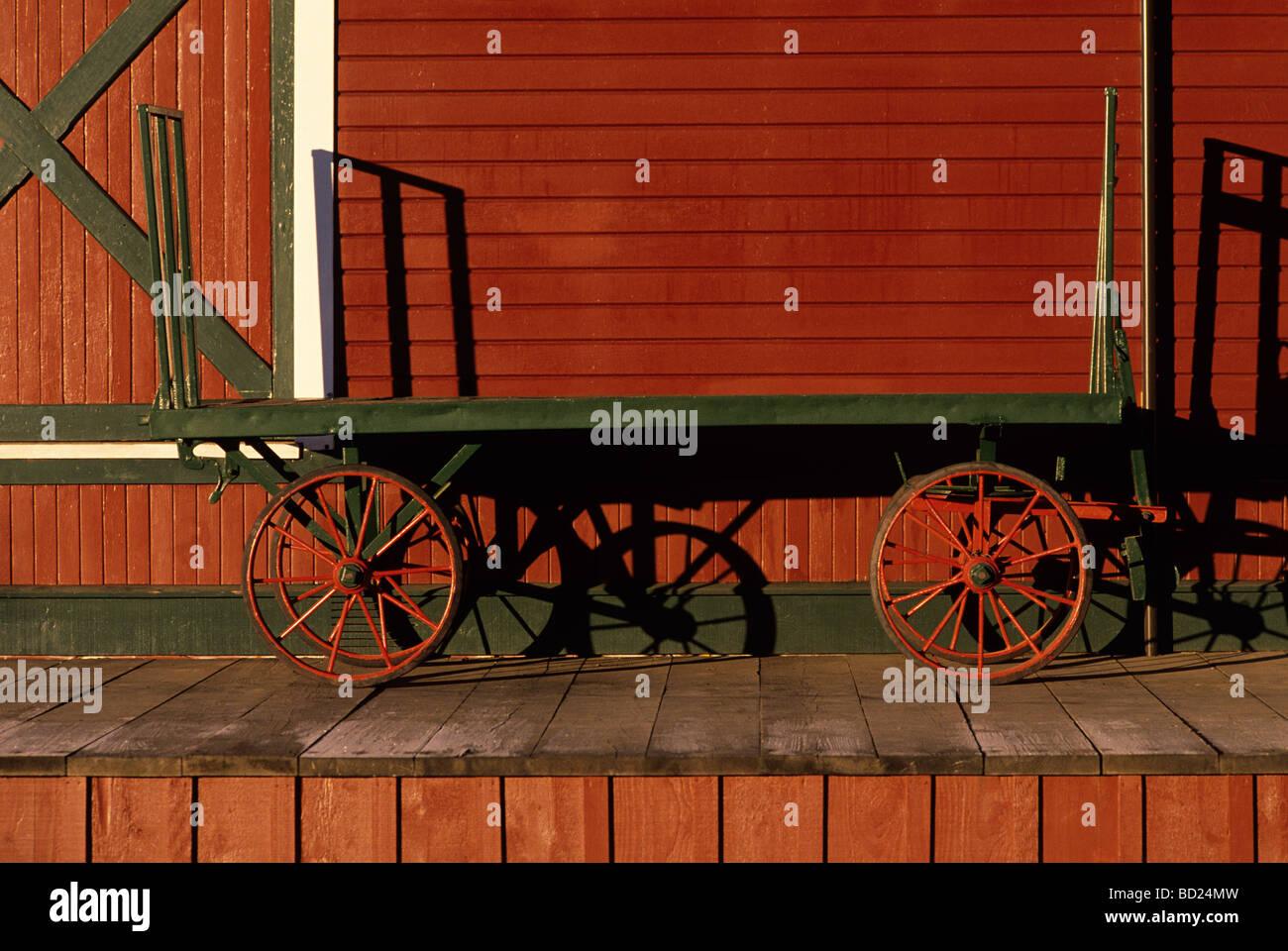 Historic train station with old time baggage cart sunrise Issaquah Washington State USA - Stock Image