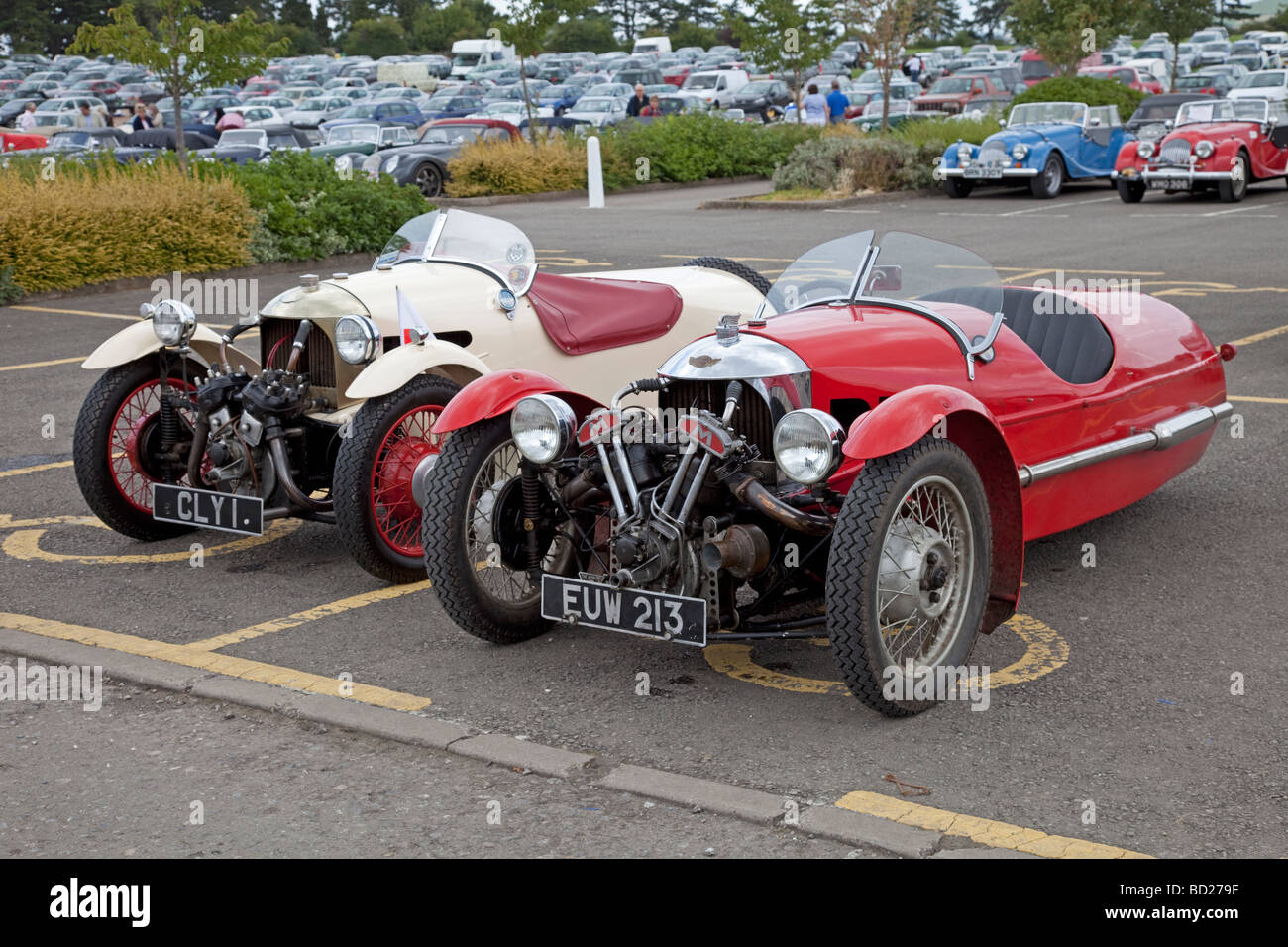 Two Morgan Three Wheeler Motor Cars Red And White Parked In Front Of Stock Photo Alamy