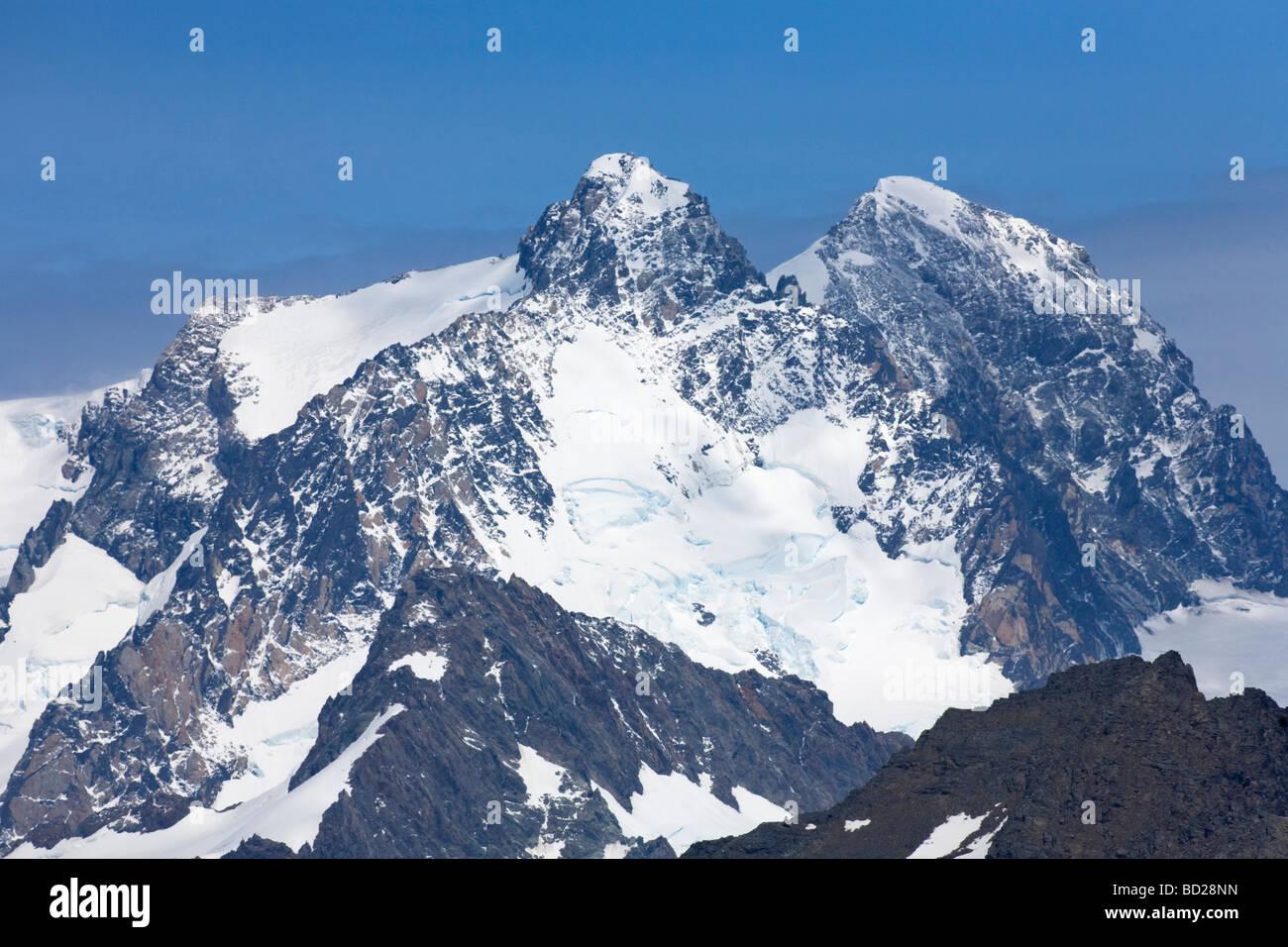 Mountain peaks behind Gold Harbour South Georgia Antarctica - Stock Image