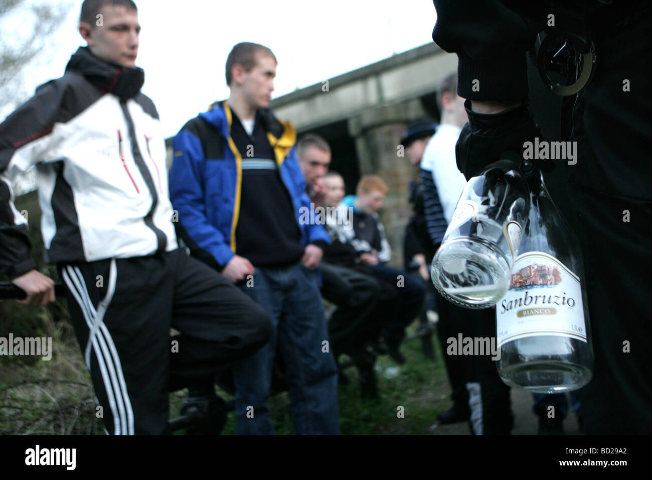 Police seize alcohol from underage drinkers. - Stock Image