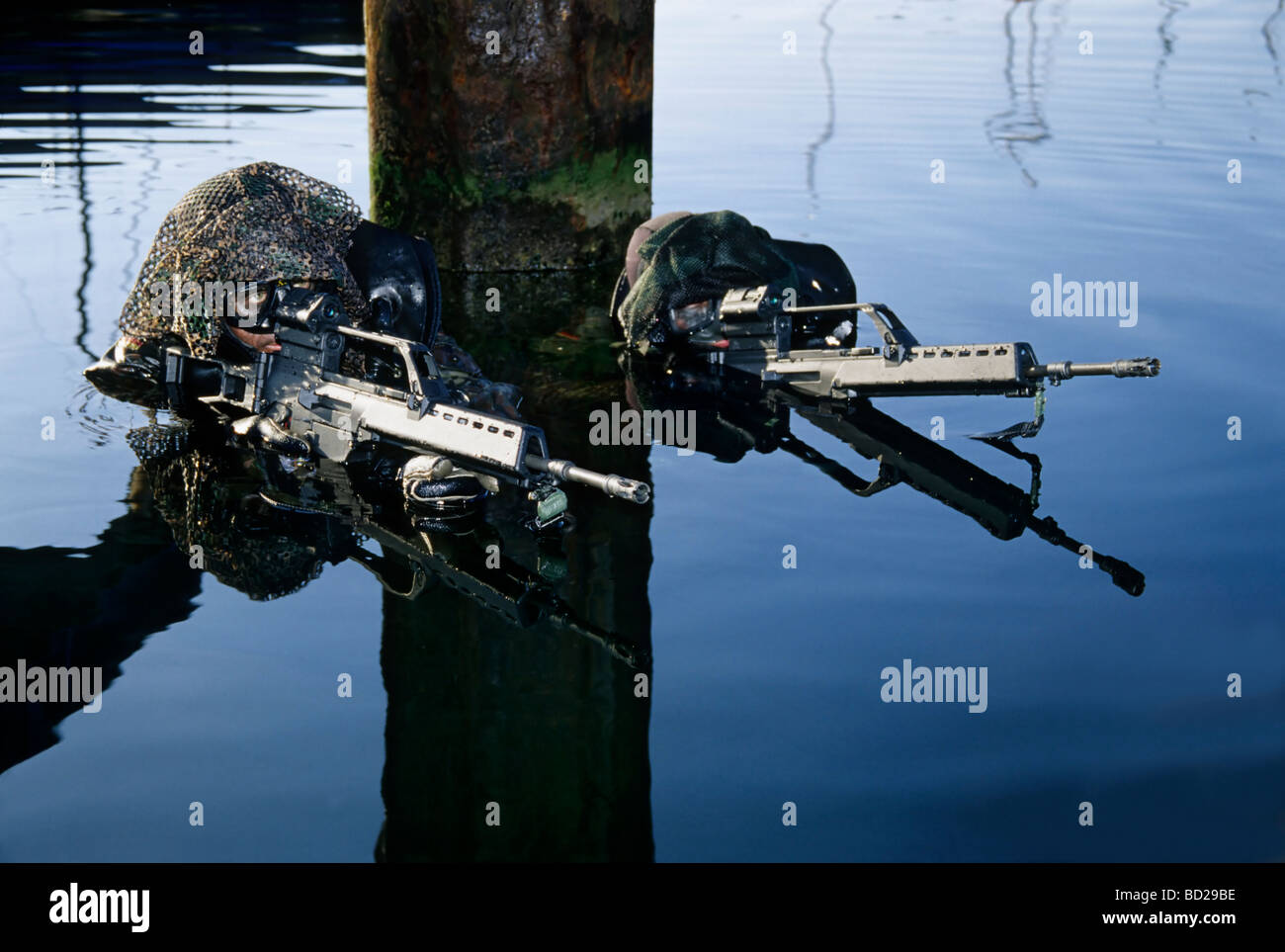 Soldiers of the special forces unit 'Kampfschwimmer' of the Deutsche Marine Germany Navy in simulation of - Stock Image