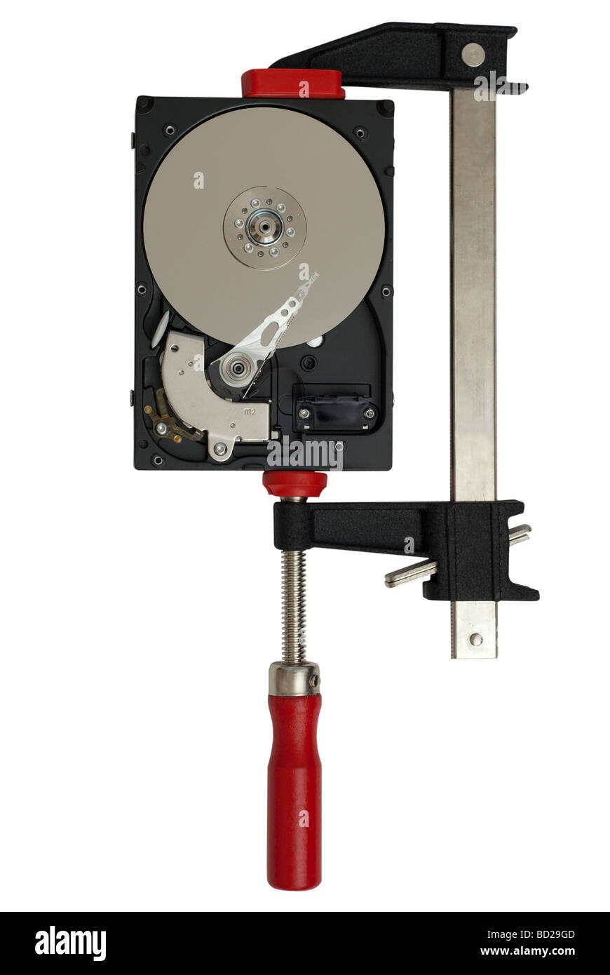 Open hard disk drive in a clamp or vise to visualize the concept of data storage and compression, isolated on white - Stock Image