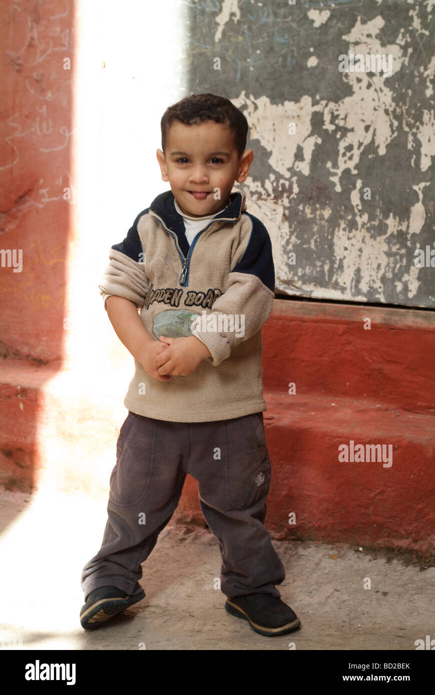 Little boy smiling and sticking his tounge out Tangier Morocco - Stock Image