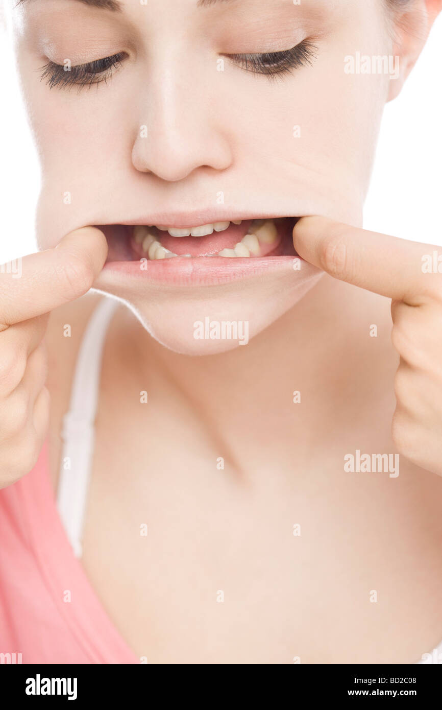 Woman stretching her mouth - Stock Image
