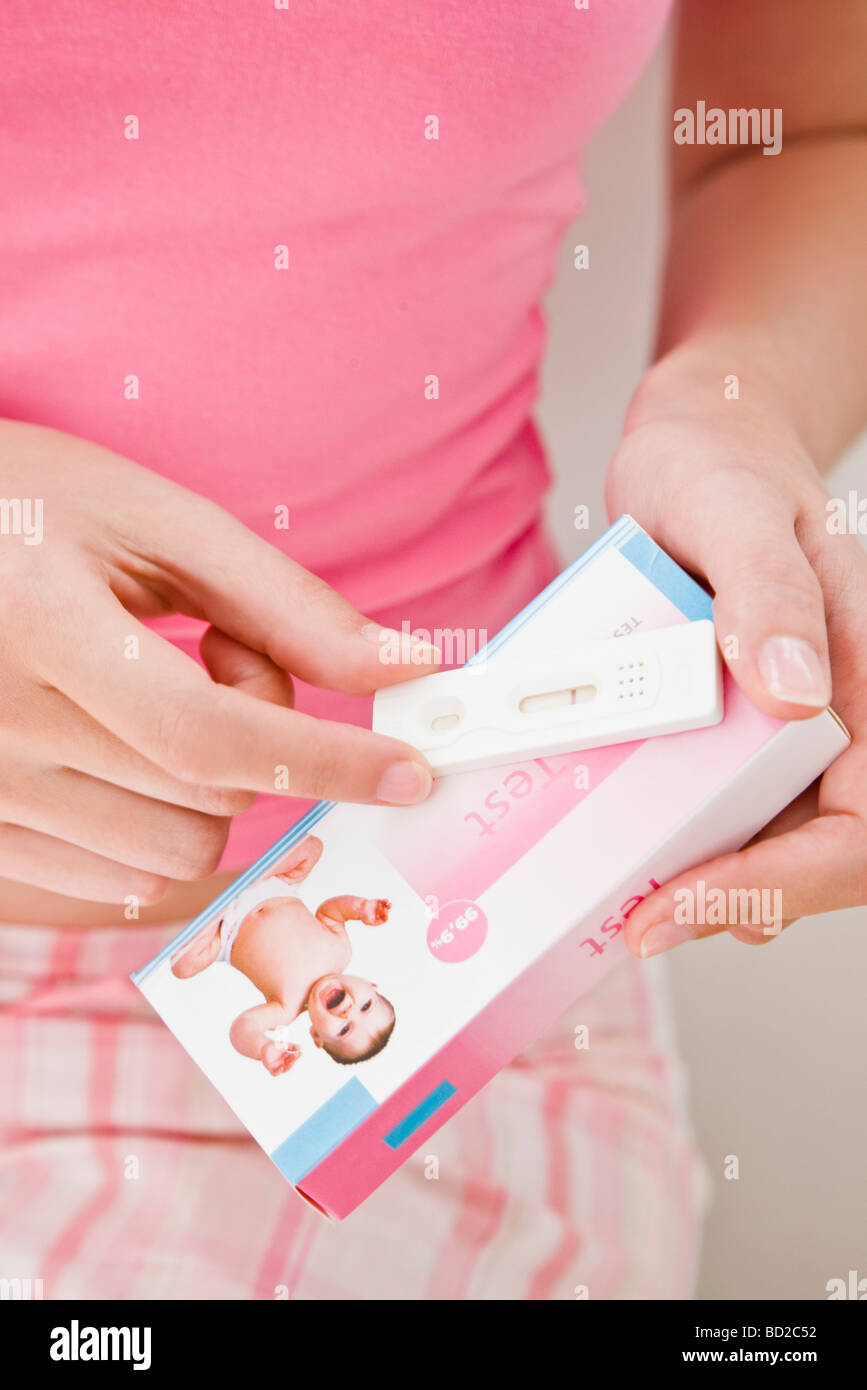 woman holding a pregnancy test Stock Photo