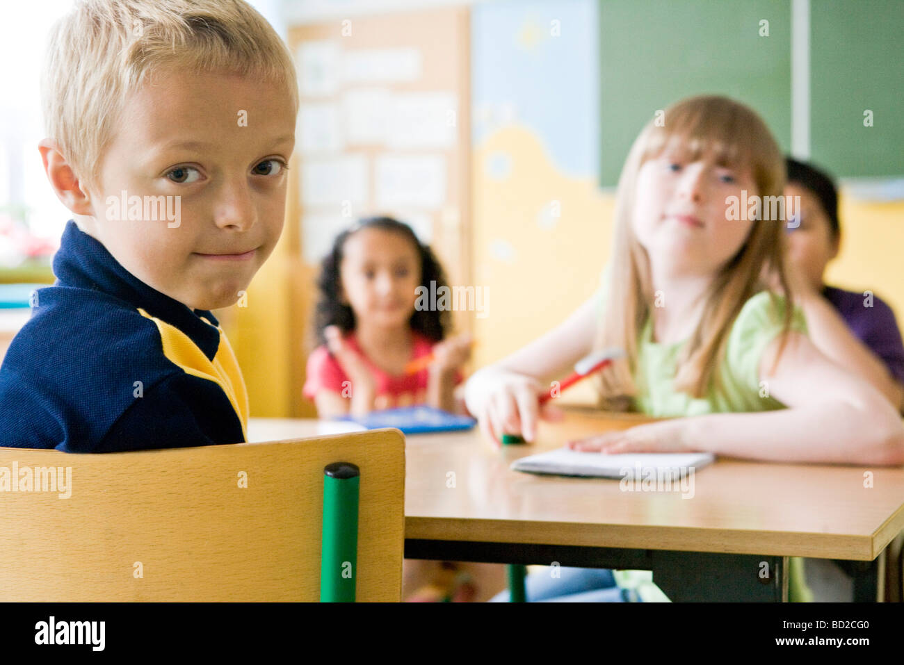 Children studying at school - Stock Image